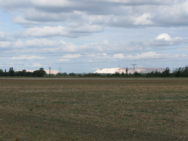 Looking NW across fields to mounds of Granite chippings